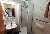 Bathroom with shower in Hotel Sissi in the heart of Budapest